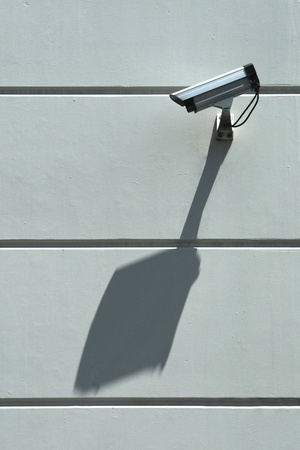Security camera and big diagonal shadow on wall directedn along the wall watching private space Stock Photo - 11532150