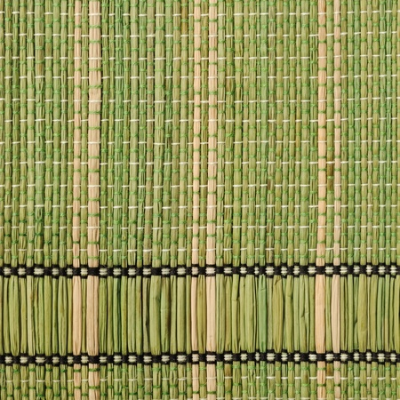 Texture of traditional straw table mat from bonded bamboo  photo