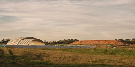 Panorama of concrete overpass base and elevated earth level at sunrise in Victoria, Australia photo