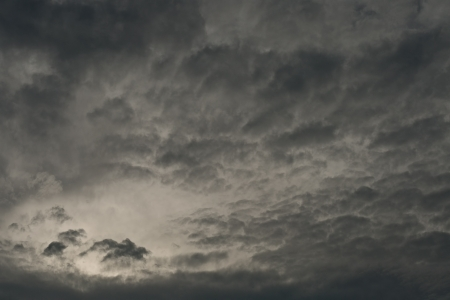 could: Dark dramatic stormy clouds with light beam and clear space in corner Stock Photo