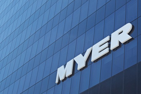 White Myer logo on blue wall of the office building in Melbourne, Australia