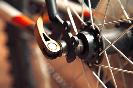Bicycle wheel with knitting needles Stock Photo