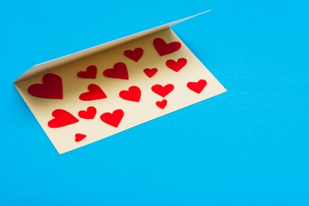Greeting card with hearts on lying on a background