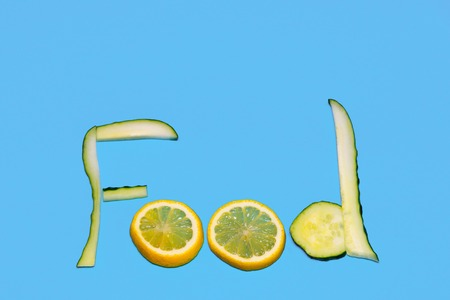 The inscription is a meal lined with cucumber and lemon on the background Stock Photo