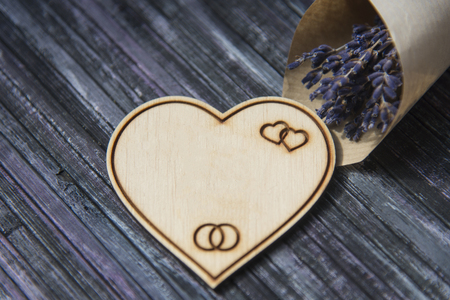 Wooden heart. Place to write. Lavender bouquet. Wooden heart with engraving. Copy space Stock Photo