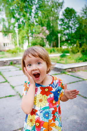 surprised baby: Surprised baby girl outside. Happy little girl screaming