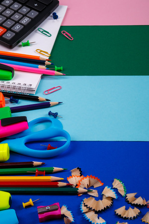 School or office stationery on colorful background. Back to School. Frame, copy space. Top view. supplies