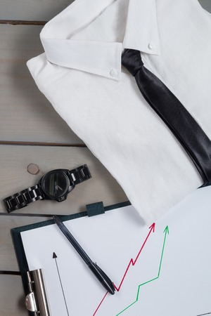 mans watch: Businessman, work outfit on grey wooden background. White shirt with black tie, watch, belt, oxford shoes, planchette. Back to work. Copy space, frame. Set of mans fashion and accessories. Stock Photo