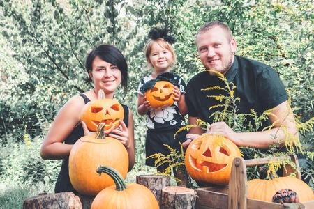 Family preparation for Halloween in the garden near Jack-o-Lantern decorations. Happy. Father, Stock Photo