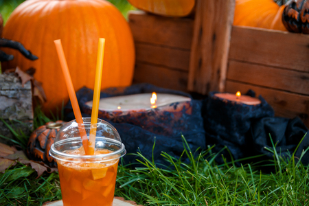 terrifying: Halloween cocktail with pumpkins decoration Punch for a party. Jack-o-Lantern. Stock Photo