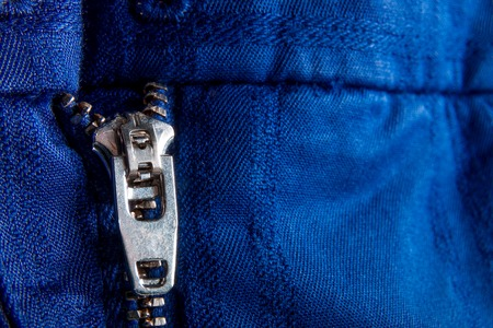 sewn up: Fragment of blue jacket with metal zipper.