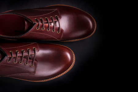 brogues: Brown oxford shoes on black background. Top view.