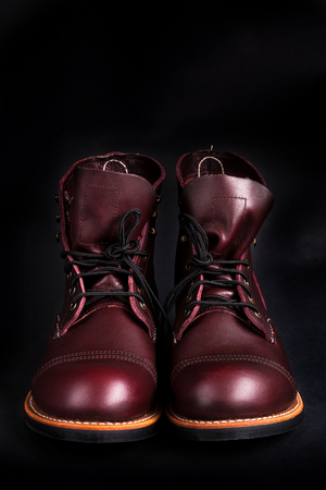 brogues: High boots. Fashionable mens leather brown shoes on black background. Back view Stock Photo