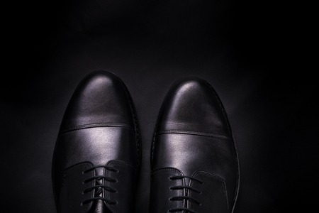 brogues: Black oxford shoes on black background Copy space. Stock Photo