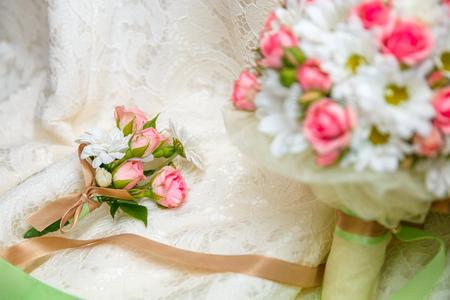 Wedding bouquet, flowers roses on dress golden