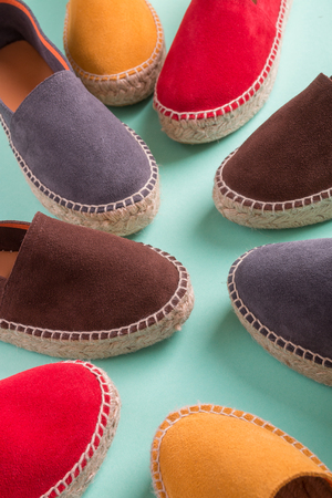 Four pair of espadrilles on mint color background. Close up Stock Photo