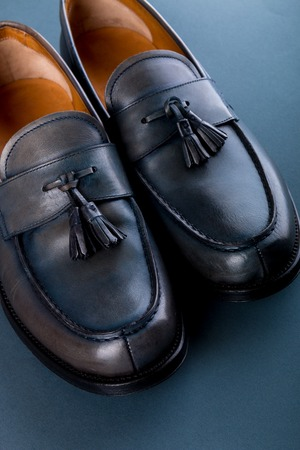 loafer: Blue loafer shoes on blue background. One pair. Top view