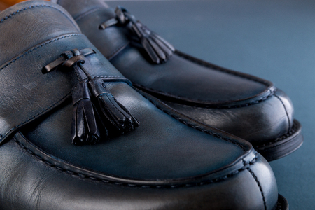 loafer: Blue loafer shoes on blue background. One pair. Close up