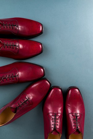 brogues: Red oxford shoes on blue background. Three pair  brogues. Top view