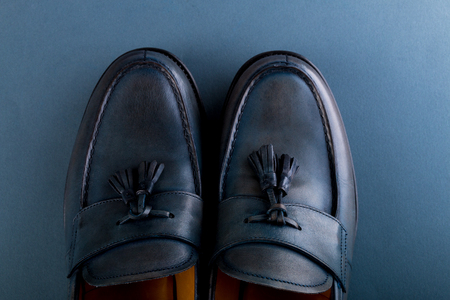 loafer: Blue loafer shoes on blue background. One pair. Top view. Copy space