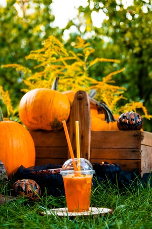 terrifying: Halloween cocktail with pumpkins decoration on background. Punch for a party. Jack-o-Lantern Stock Photo