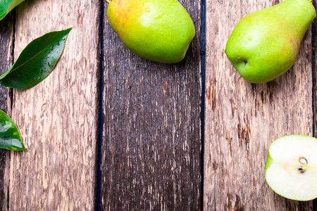 Pear on wooden rustic background. Top view. Frame. Autumn harvest. Copy space