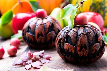 Jack-o-lantern on wooden background. Autumn concept. Halloween