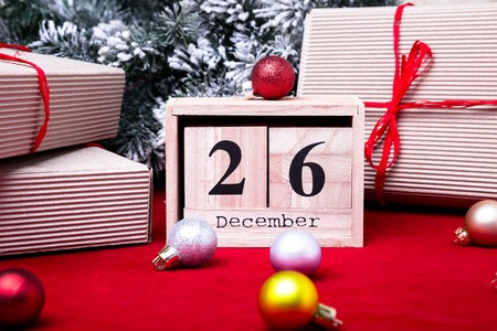 Boxing Day Sale. Calendar with date on red background. Christmas concept. December 26. Christmas ball and gifts.