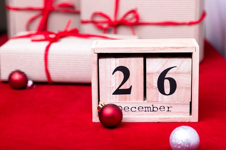 boxing day: Boxing Day Sale. Calendar with date on red background. Christmas concept. December 26. Christmas ball and gifts.