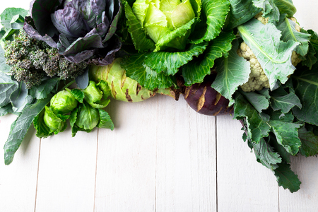 Various of Cabbage Broccoli Cauliflower. Assorted of Cabbages on white wooden background. Flat lay Standard-Bild