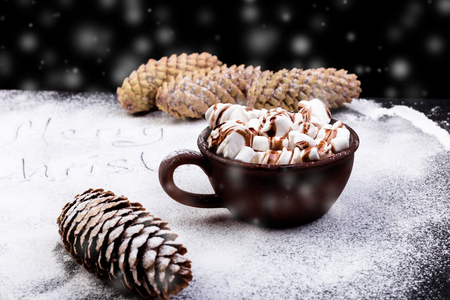 retro christmas: Christmas Food Sweet Marshmallow with Chocolate in Brown Cup on Black Background.  Stock Photo