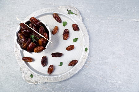 Dry fruit dates on silver tray. Copy space. Top view