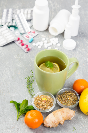 Alternative remedies and traditional pills to treat colds and flu. Natural medicine vs conventional medicine concept. Copy space.
