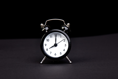 Black vintage alarm clock. Eight oclock. Copy cpace. Wake time