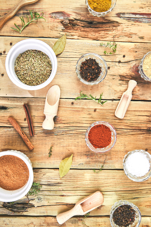 Flat lay of Seasoning background. Spice and herb seasoning with fresh and dried herbs and spices in bowls. Colourful various herbs and spices for cooking on wooden rustic background. Top view. Stok Fotoğraf