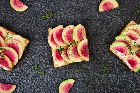 Healthy breakfast toasts from sliced watermelon radish