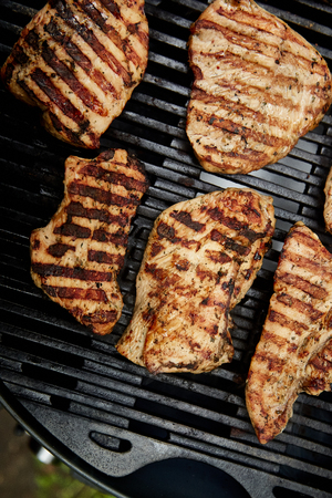 Grilled turkey meat. Steak turkey grill on on huge gas grill . Picnic. Summer. Top view. Flat lay. Copy space.