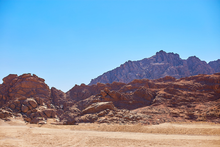 Desert on a background of mountains. Beautiful sand dunes in the desert. Copy space.