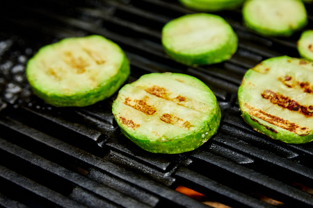 Grilled zucchini vegetable on huge gas grill . Vegan food. Diet, healthy Picnic. Summer. Top view. Flat lay. Copy space. Imagens