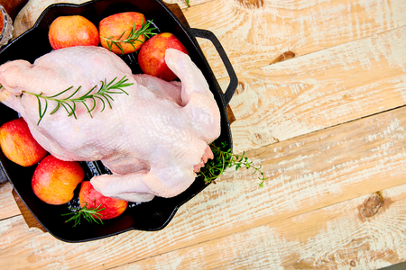 Whole raw chicken with ingredients. Cooking background.