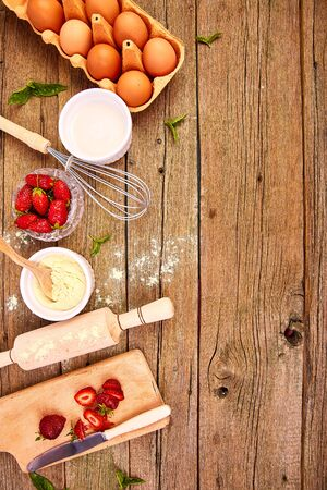 Raw ingredients for cooking strawberry pie or cake on rustic background. T
