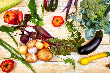 Different vegetables for eating healthy on wooden background.