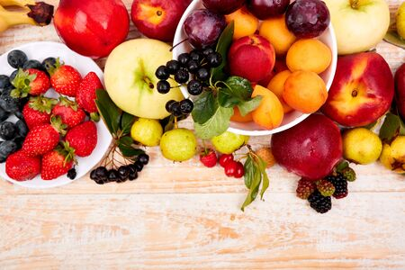 Flat lay of fruits over white wooden background