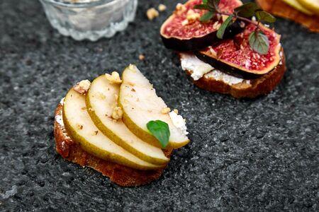 Bruschetta and Crostini with pear, ricotta cheese, honey, figs.