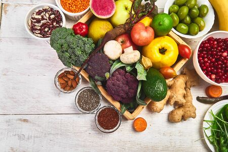Healthy balanced vegan dieting concept. Vegetables fruit seeds beans ingredients for cooking. Organic vegetables, detox diet, close up. Top view. Flat lay. Copy space. Free for text.