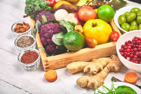 Selection of superfoods on white wooden background. Organic food and healthy vegan food. Top view. Flat lay. Copy space. Free for text.