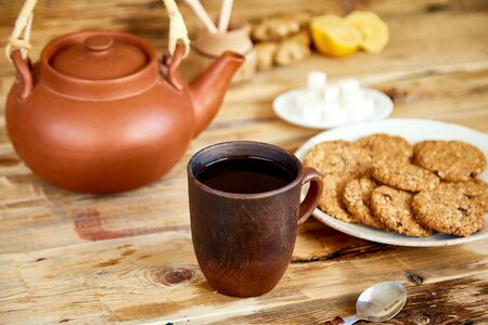 Afternoon tea, Tea Ceremony, Teapot Honey Cups of tea with cookies, biscuits on Old Rustic wooden Table Background.