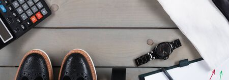 Banner with Businessman, work outfit. White shirt with black tie, watch, belt, oxford shoes, planchette and calculator. Back to work. Copy space, frame. Set of mans fashion and accessories.