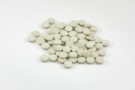 calcium: Calcium tablets on white background Stock Photo