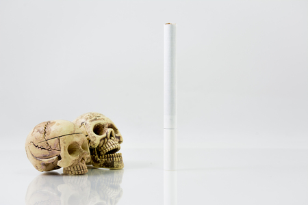 Smoking can kill you. Still Life with a Skull concept, white background